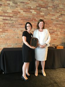 Jaclyn Kiger accepting the Distinguished Young Lawyer Award from presenter Lee Ann Mangone.