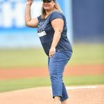 President Natalie Bacon winds up to throw out the first pitch...